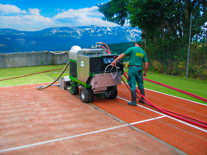 Artificial turf cleaning for tennis courts